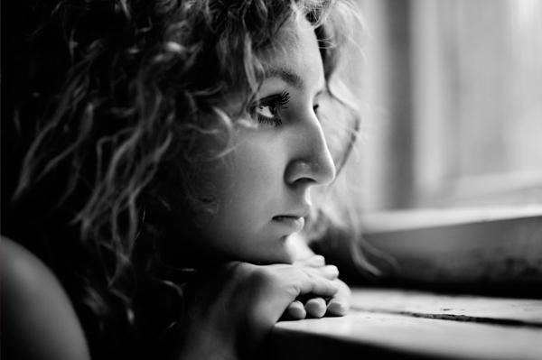 sad-woman-looking-out-dark-window[1]