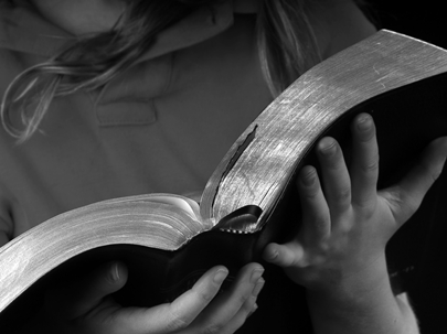 319720_1_e5af7d.bigstock-young-girl-reading-bible-vers